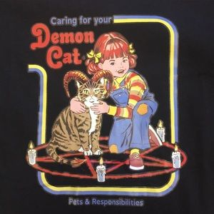 """Caring for your demon cat"" instructional book tee"